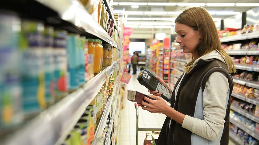 Sales assistant scanning products before putting them on shelves #21083161