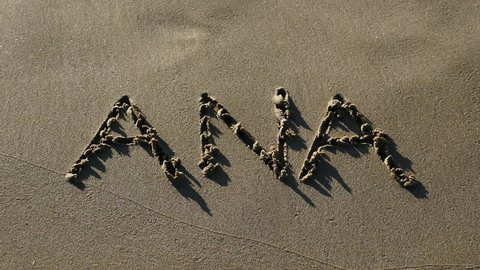 """Word """"ANA"""" written in the sand and erased by a sea wave. Shot on a beach in Alicante, Spain, in November 2016."""