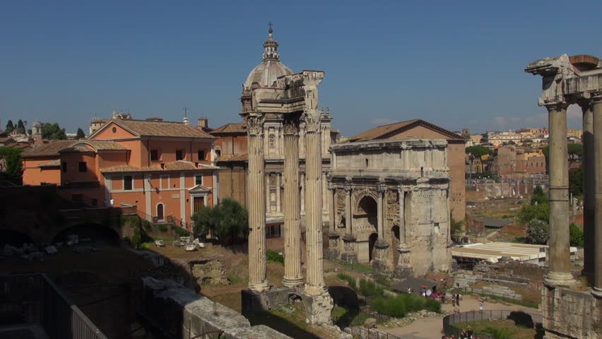 The Roman Forum (Latin: Forum Romanum, Italian: Foro Romano) is a rectangular forum (plaza) surrounded by the ruins of several important ancient government buildings at the center of the city of Rome. | Shutterstock HD Video #21084844