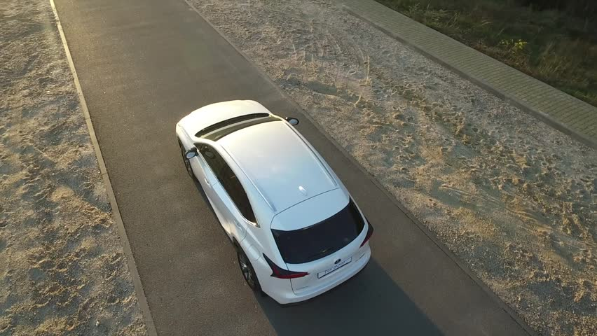 Circling around the Lexus NX. Sunset. Shooting from the air. The white car. Road.   Shutterstock HD Video #21097492