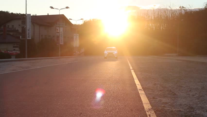 The movement of the camera at sunset. Lexus NX. Acceleration. The white car.   Shutterstock HD Video #21097495