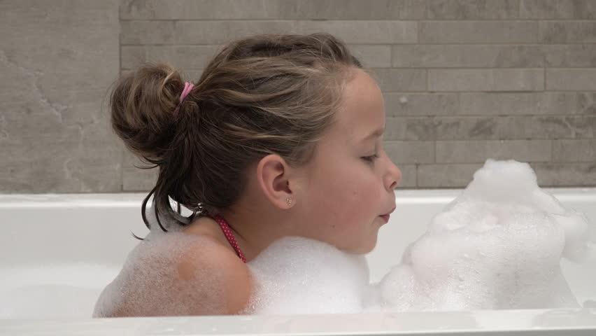 Young teen bathing nude in bathroom