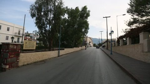 POROS, GREECE - OCT 2, 2016: Riding on the roads and residential areas of Poros island. Its surface area is about 31 square kilometres (12 sq mi) and it has 3,780 inhabitants.