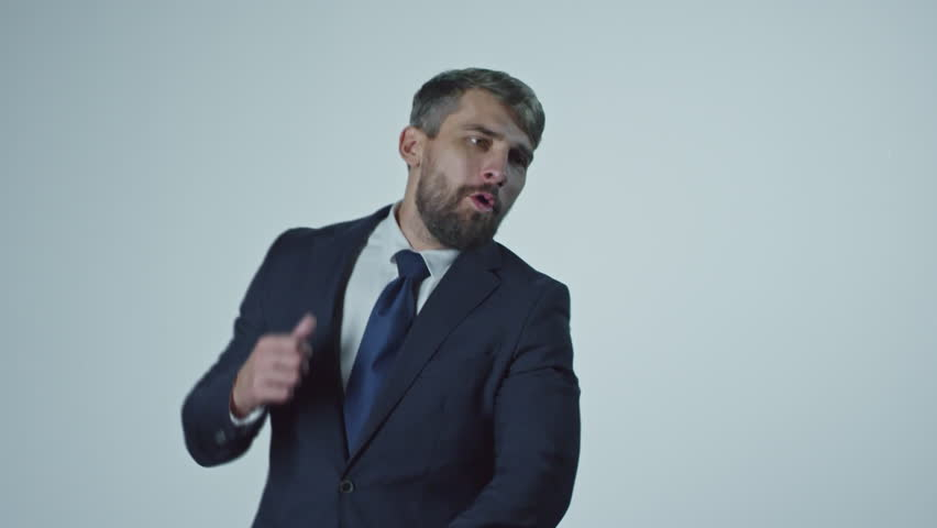 Portrait of ecstatic businessman with beard dancing enthusiastically as money falling on him from above | Shutterstock HD Video #21121288