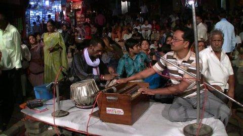 VARANASI, INDIA - NOVEMBER 17: Unidentified Hindu musicians preparing for the   religious Ganga Aarti ritual (fire puja) at Dashashwamedh Ghat on November 17, 2011 in Varanasi, Uttar Pradesh, India