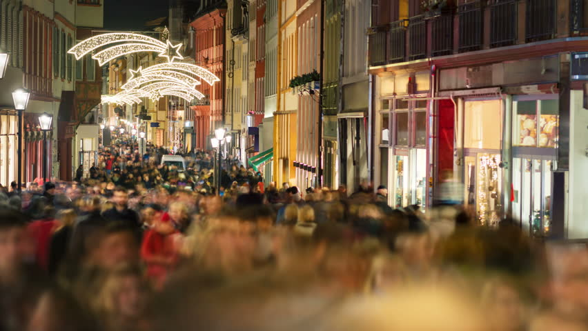 Big crowd of people walking through the main shopping street in Heidelberg, Germany, at Christmas, time lapse video