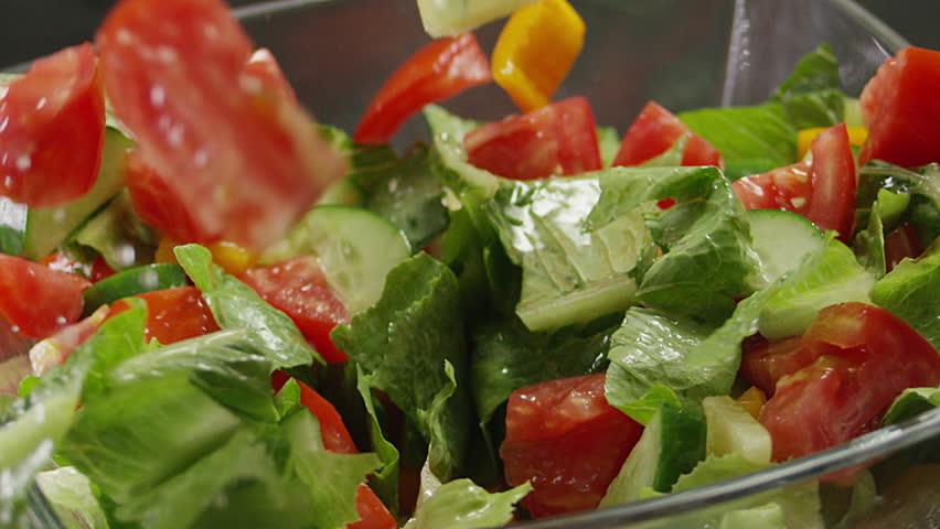 Salad preparation process. Process of mixing fresh salad. Shot on RED EPIC DRAGON Cinema Camera. #21157432