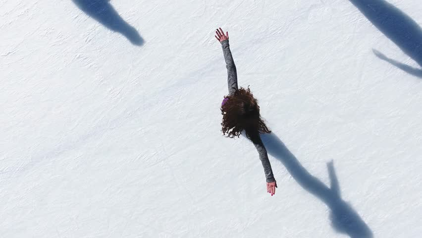 Aerial view of ice skating woman outdoor, ice rink Medeo | Shutterstock HD Video #21158962