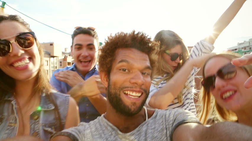 Close up of happy crazy multi-ethnic group of friends filming themselves at rooftop party on sunny day, graded | Shutterstock HD Video #21176407