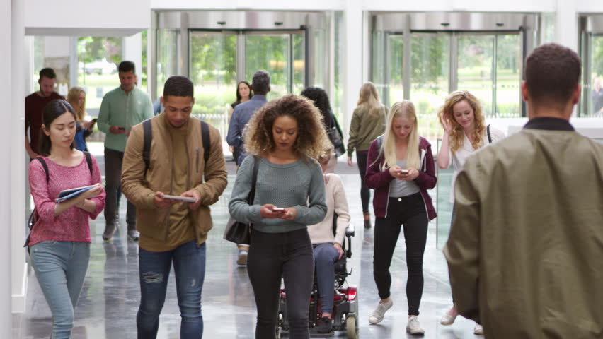 Students walking through the foyer of a modern university, shot on R3D Royalty-Free Stock Footage #21195964