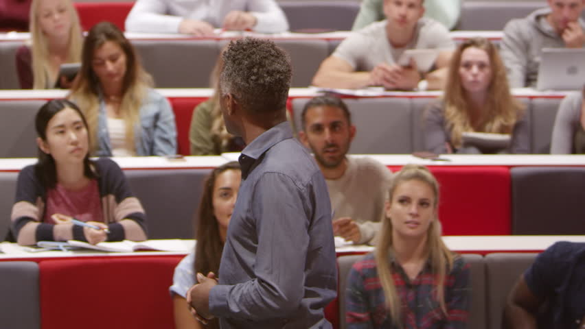 Back view of male teacher lecturing university students, shot on R3D | Shutterstock HD Video #21202279