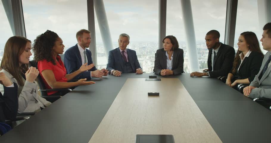 4k, A team of suit-clad business people having a heated debate in boardroom meeting. Slow motion.