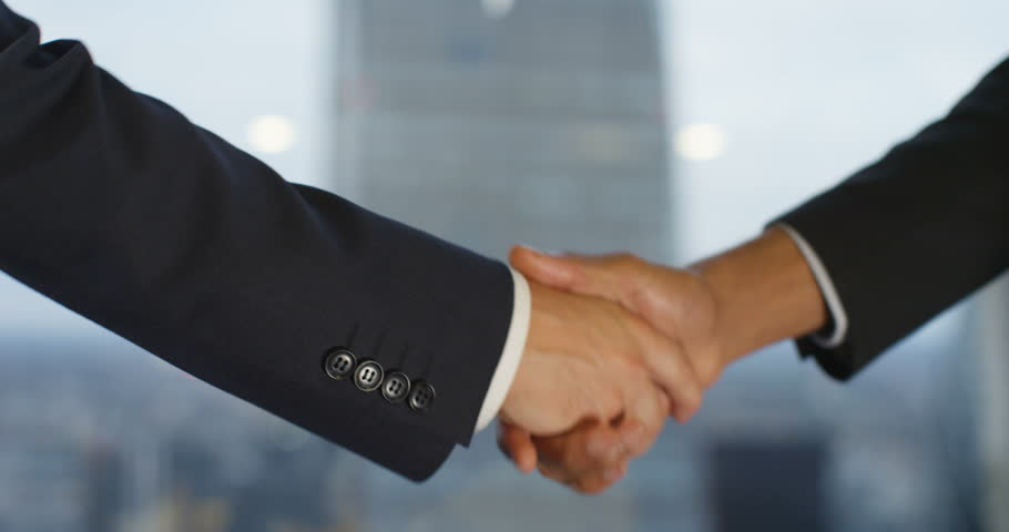 4k, Closeup shot of a two business people shaking hands. Slow motion. #21224767