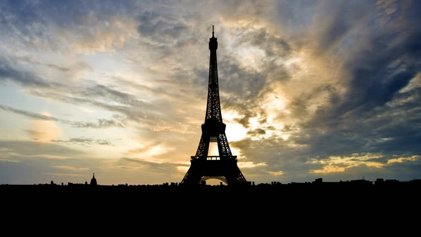 The Eiffel Tower is the most recognizable landmark of Paris, France. Built in 1889 as the entrance arch to the 1889 World's Fair it have become the world known attraction.    | Shutterstock HD Video #2124221
