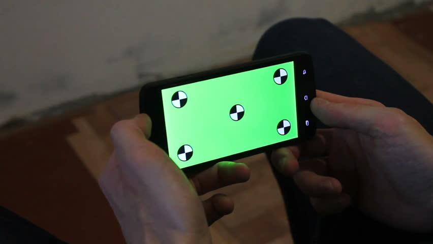 A young man and a green screen smartphone   Shutterstock HD Video #21246580