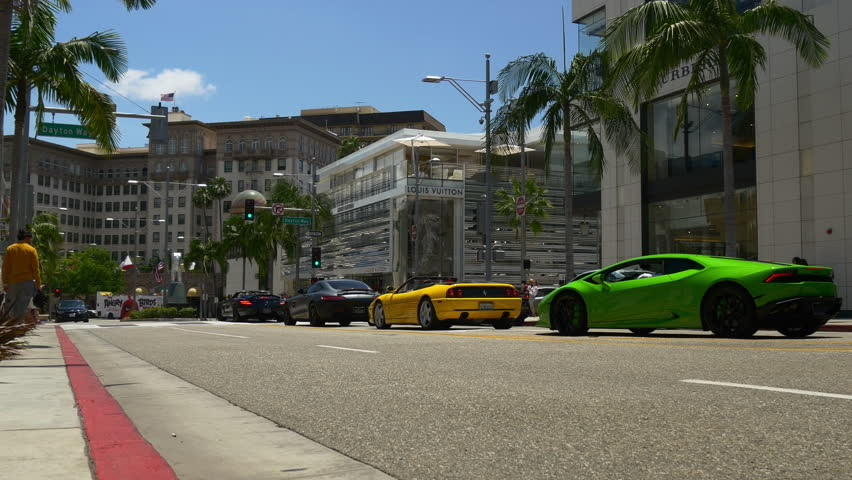 Los angeles famous rodeo drive luxury cars traffic panorama 4k usa