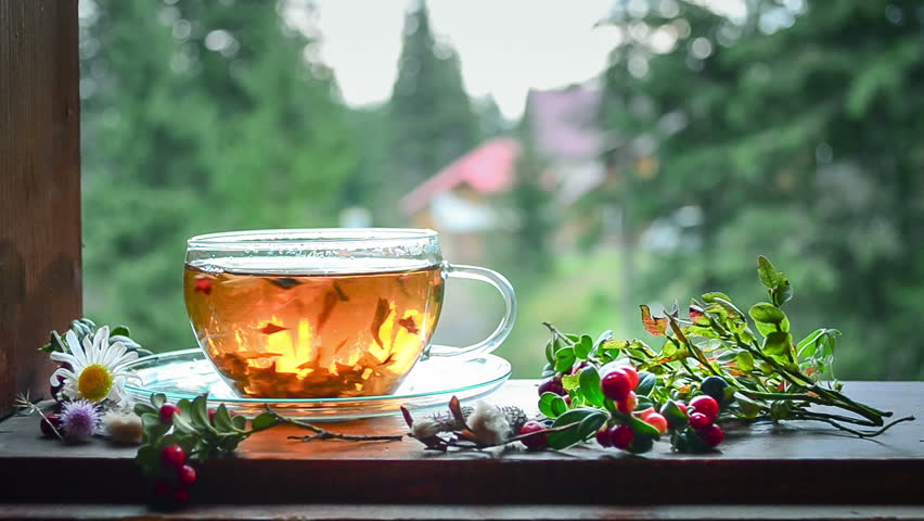 Cup of tea on the window sill. Tea leaves at the bottom of the cup. Tea time.   Shutterstock HD Video #21254695
