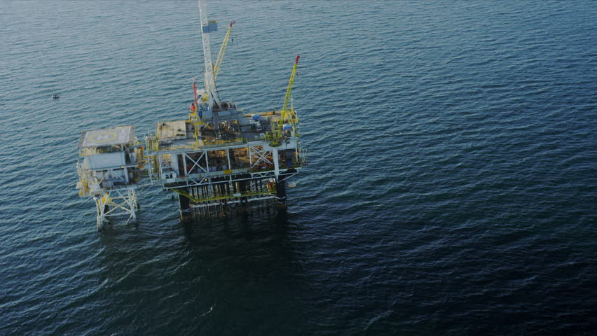 Aerial view of working oil rig deep water production platform, America, USA