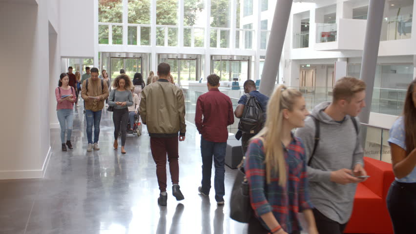 Students walk through the foyer of a modern university Royalty-Free Stock Footage #21267346