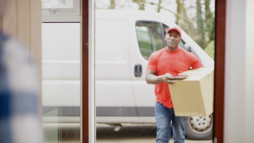 4K Friendly delivery driver bringing package to customer's door & getting electronic signature. Shot on RED Epic.