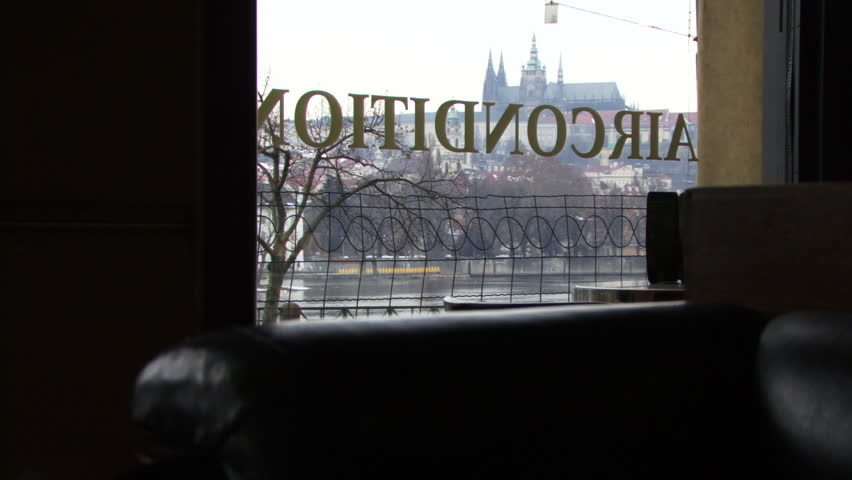 LONG SHOT, View on St Vitus's Cathedral and trams trough window in Prague, Czech Republic