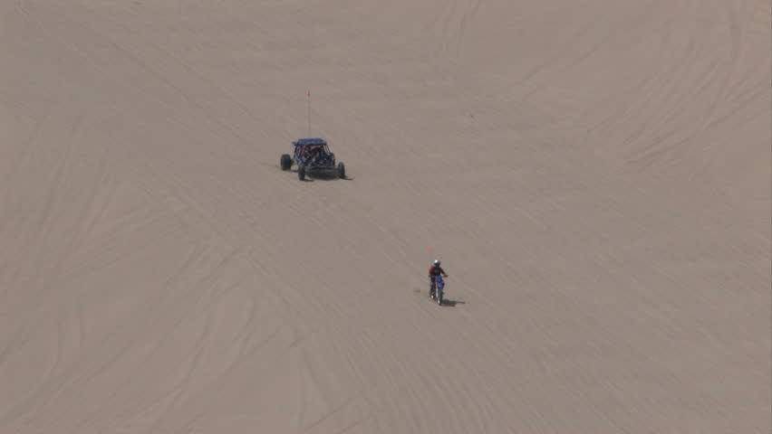 Dune buggy, ATV and motorcycles on Sand Mountain  Little Sahara recreation area Utah.  700 vertical feet of sand used for off road vehicles, fun and recreation. Racing up sand. Central Utah.