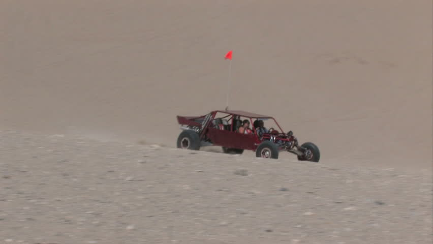 Dune buggy climbing Sand Mountain in the Little Sahara recreation area in Utah.  700 vertical feet of sand used for off road vehicles, fun and recreation.  Central Utah.