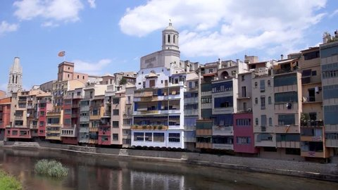 GIRONA, SPAIN - JULY 6, 2016: Colorful houses against sky in Girona, Catalonia, Spain