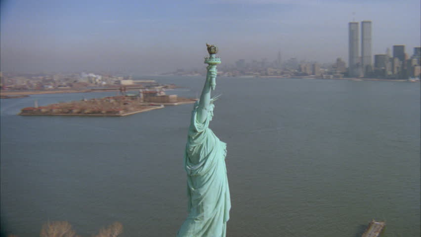 Day Aerial Circling around Statue Liberty, zooms New York Skyline World Trade Center times | Shutterstock HD Video #21356884