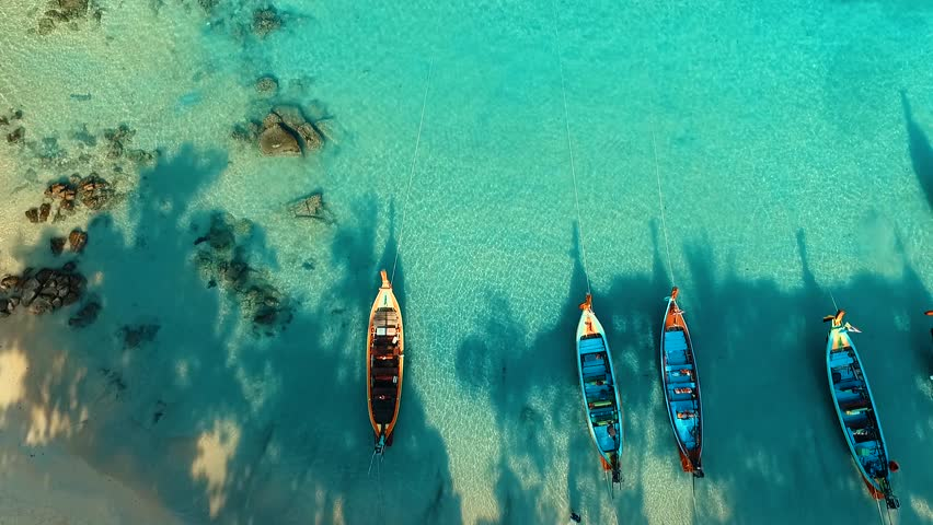 Aerial: Long tail boats on beautiful beach. | Shutterstock HD Video #21374722