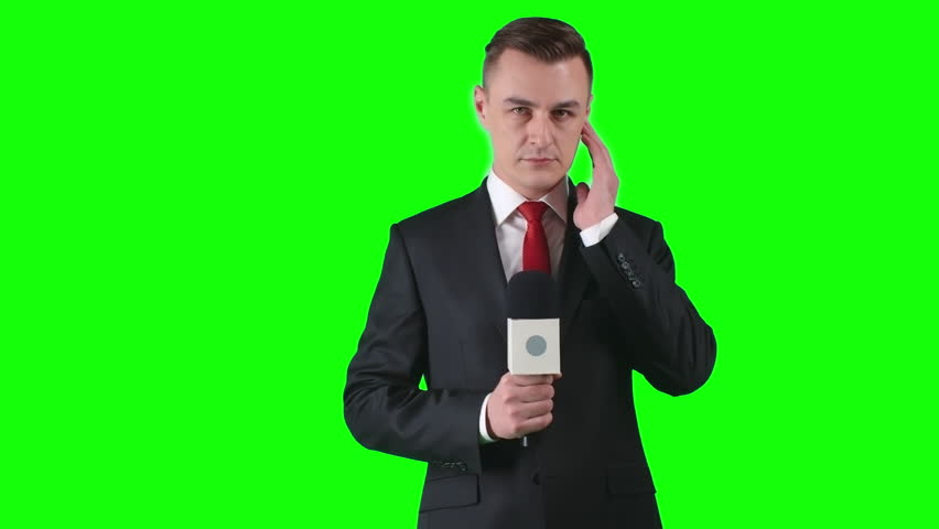 Lockdown of man in formal suit standing against green screen background gesticulating and talking passionately into microphone | Shutterstock HD Video #21385132
