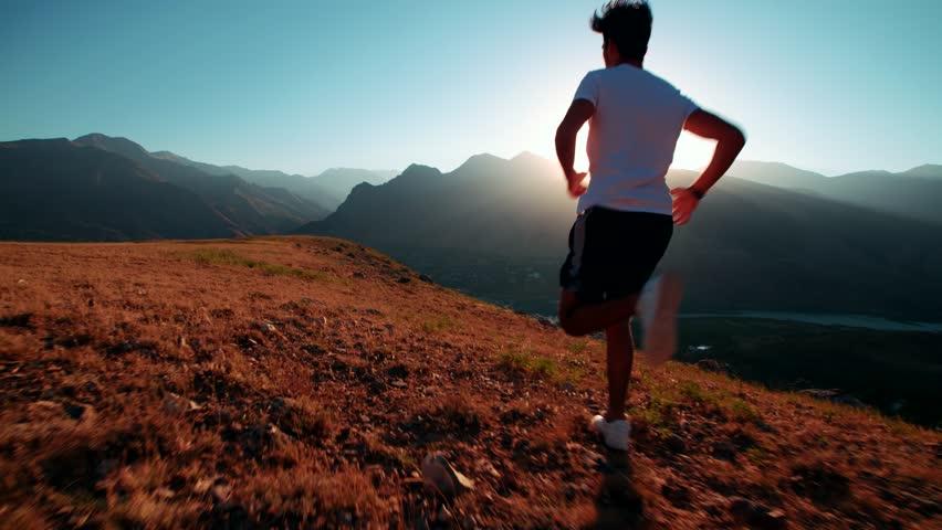 Mountain landscape Asian running man Jogging in the morning slow motion | Shutterstock HD Video #21388705