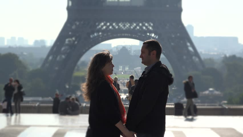 Man and woman holding hands close to Eiffel tower, romantic dating | Shutterstock HD Video #21397486