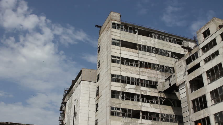 Panorama of abandoned building with broken windows. bottom view