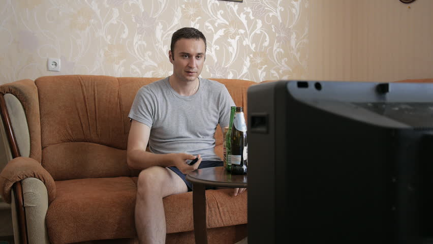 The man taking beer wanted to watch TV, but his old retro TV does not work. The man angrily turned on the TV and knocking to it. | Shutterstock HD Video #21424642