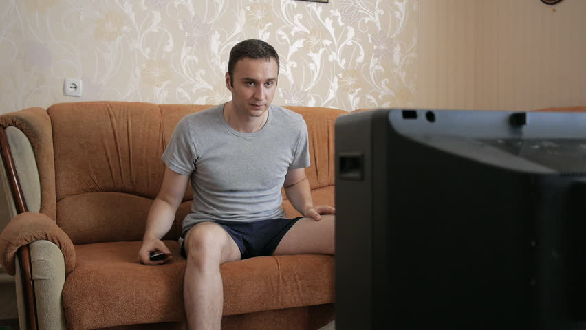 The man frustrated that his old television is not working. The man kicked in anger his vintage TV. | Shutterstock HD Video #21424651