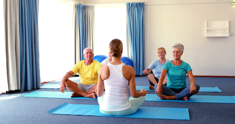 Caucasian Trainer Assisting Senior Citizens Stock Footage Video 100 Royalty Free 21425410 Shutterstock