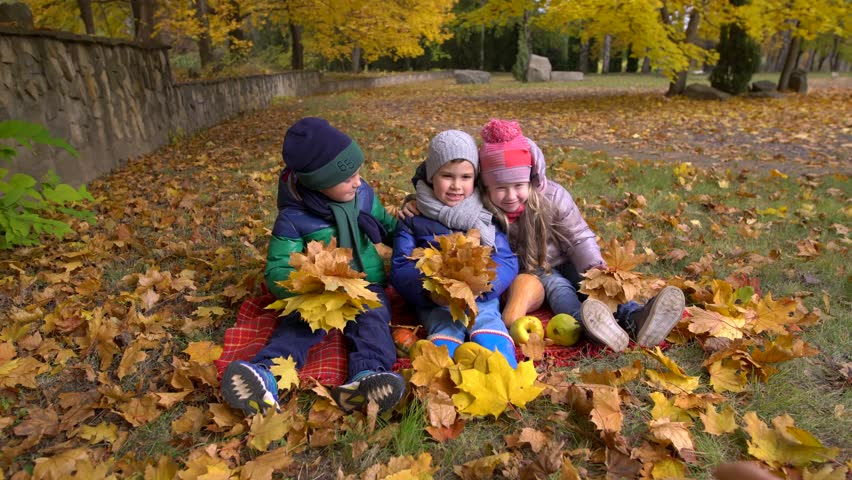 Children in yellow autumn park. Little boys and a girls standing outdoors in bright clothes.4K | Shutterstock HD Video #21452485