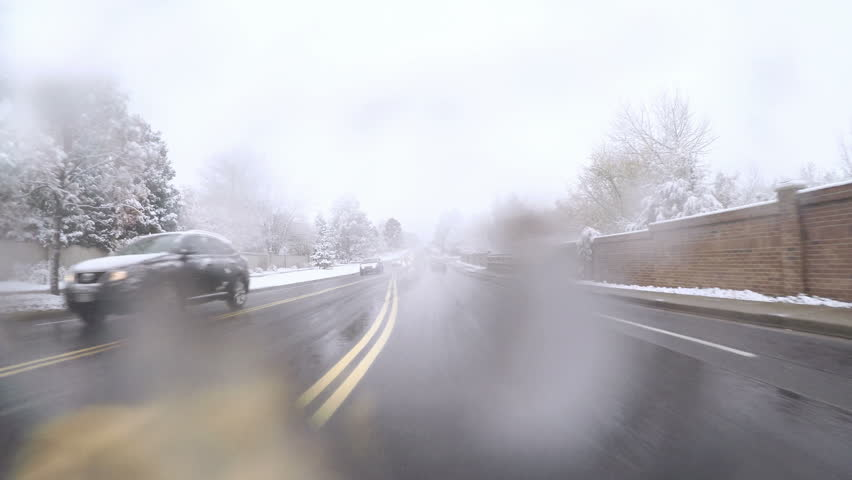 Denver, Colorado, USA-November 17, 2016. POV point of view - Driving in first snow storm of the season.   Shutterstock HD Video #21468034