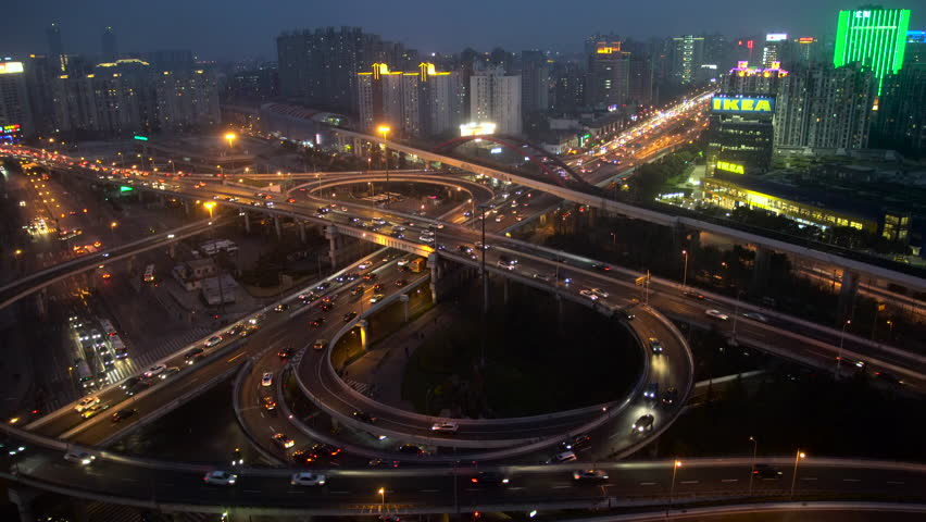 Shanghai, China - March 2016: Busy elevated stacked road junction at dusk | Shutterstock HD Video #21480937