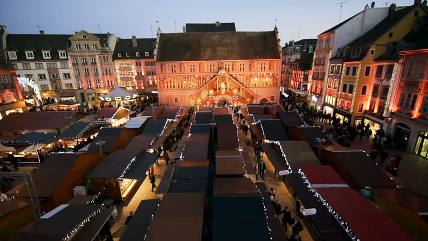Aerial magic view from a Ferris wheel over Christmas Market with Cathedral Temple Saint-Etienne behind during best Christmas Market in French city of Mulhouse in Place de la Reunion drone Christmas