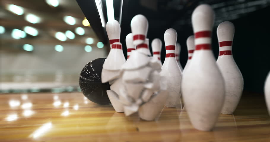 Bowling ball hits the pins and explodes them in super slow motion