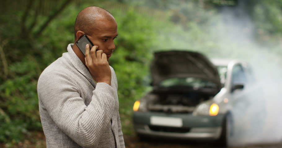 4k, A man calling roadside assistance for help with his car trouble. Slow motion.