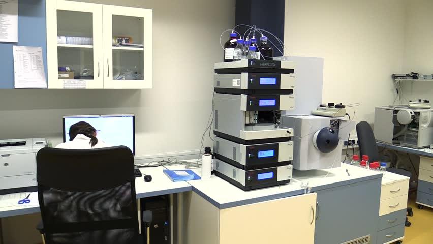 TREBON, CZECH REPUBLIC, SEPTEMBER 20, 2015: Woman scientific, laboratory tubes with algae chlorophyll, cuvette for spectrometer, chlorella, science, Europe, EU. | Shutterstock HD Video #21527764