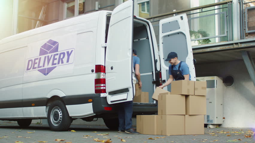 Two Smiling Movers are Loading Cargo Van with Cardboard Boxes in a Modern City. Shot on RED Cinema Camera in 4K (UHD). | Shutterstock HD Video #21531553