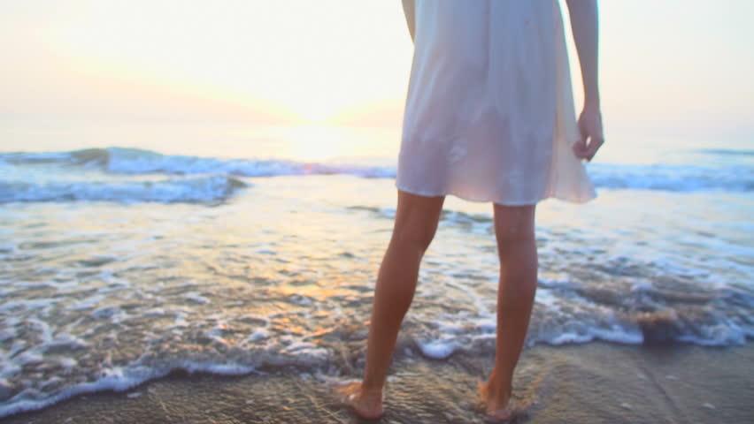 Barefoot young ethnic girl lifestyle recreation resort romantic white sun dress Summer vacation ocean beach waves   Shutterstock HD Video #21533680