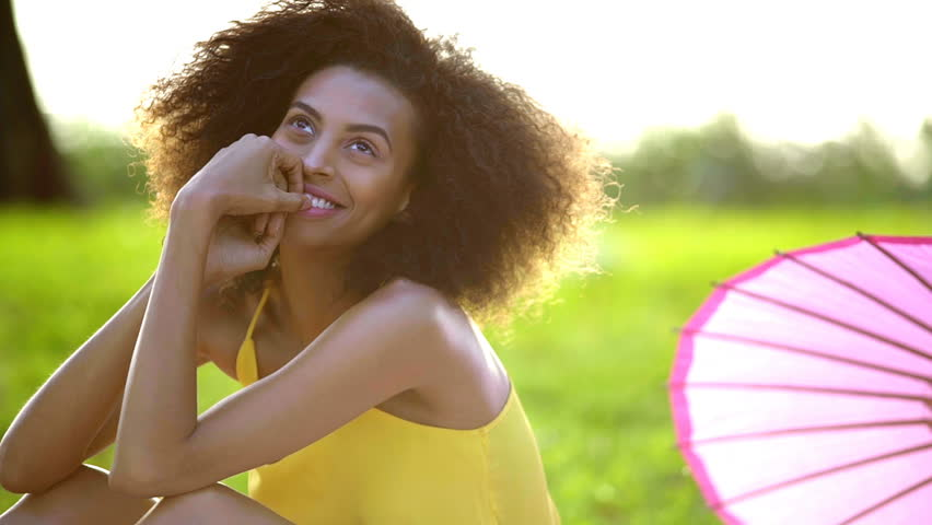 Young happy ethnic teenager afro hair leisure recreation chilling boho smile park picnic Summer holiday outdoors | Shutterstock HD Video #21535129