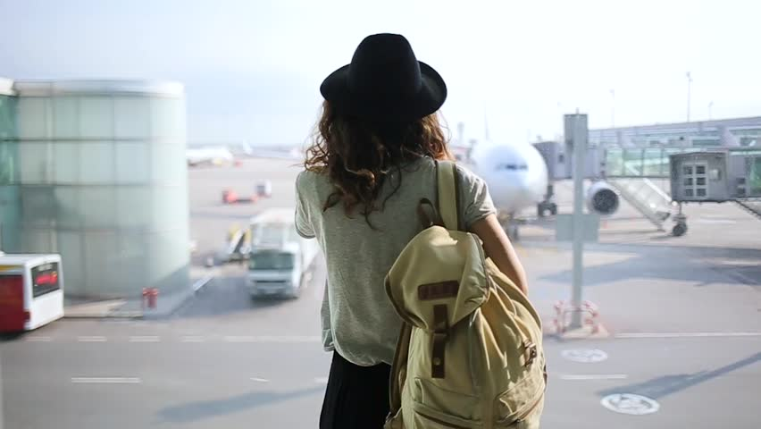 girl standing at the window in airport terminal. #21546376
