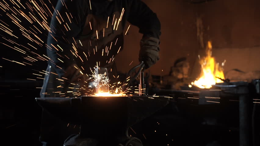 Forging hot metal in smithy