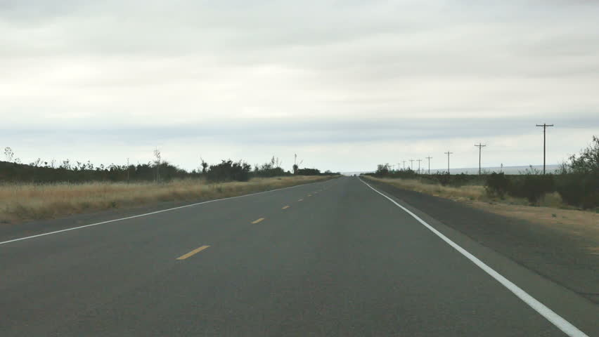 POV-Driving New Mexico State Road 11 between Columbus and Deming on a grey overcast day | Shutterstock HD Video #21553345
